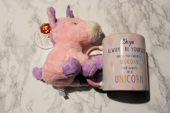 Unicorn teddy holding personalised side of mug