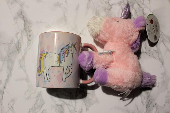 Unicorn teddy holding unicorn side of mug