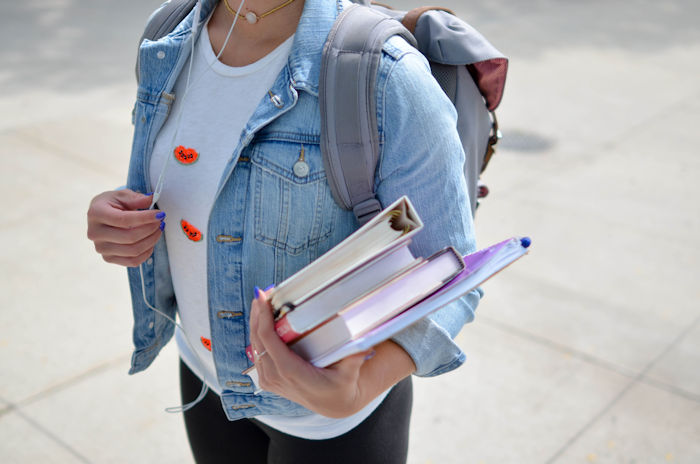 teen with books and backpack